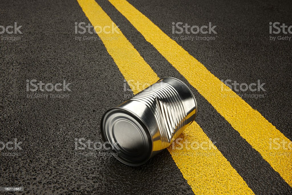 kicking can down the road royalty-free stock photo