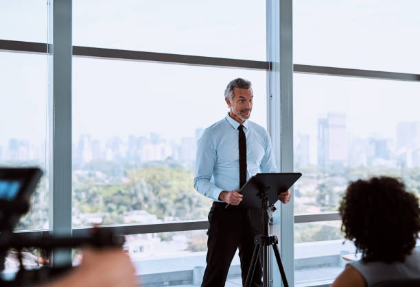 Kicking off the presentation with an eye opening speech stock photo