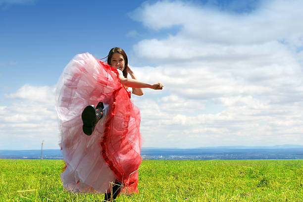 kicking - petticoat stock pictures, royalty-free photos & images