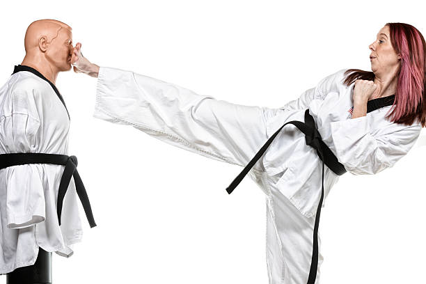 kicking reach - martial arts gerville stock photos and pictures