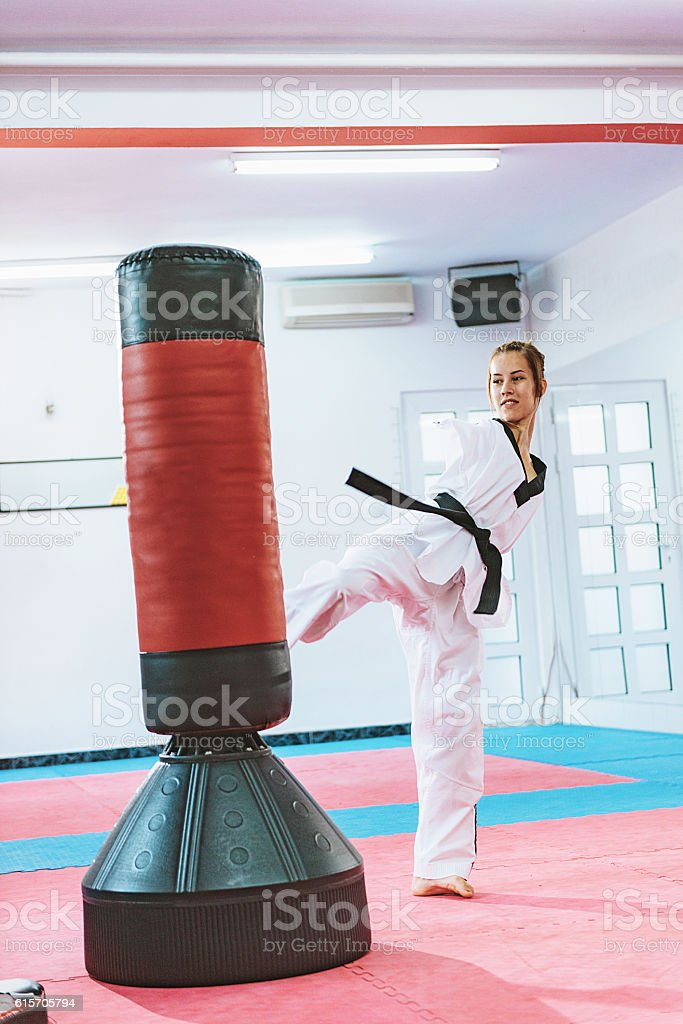 Kicking the bag on taekwondo training stock photo