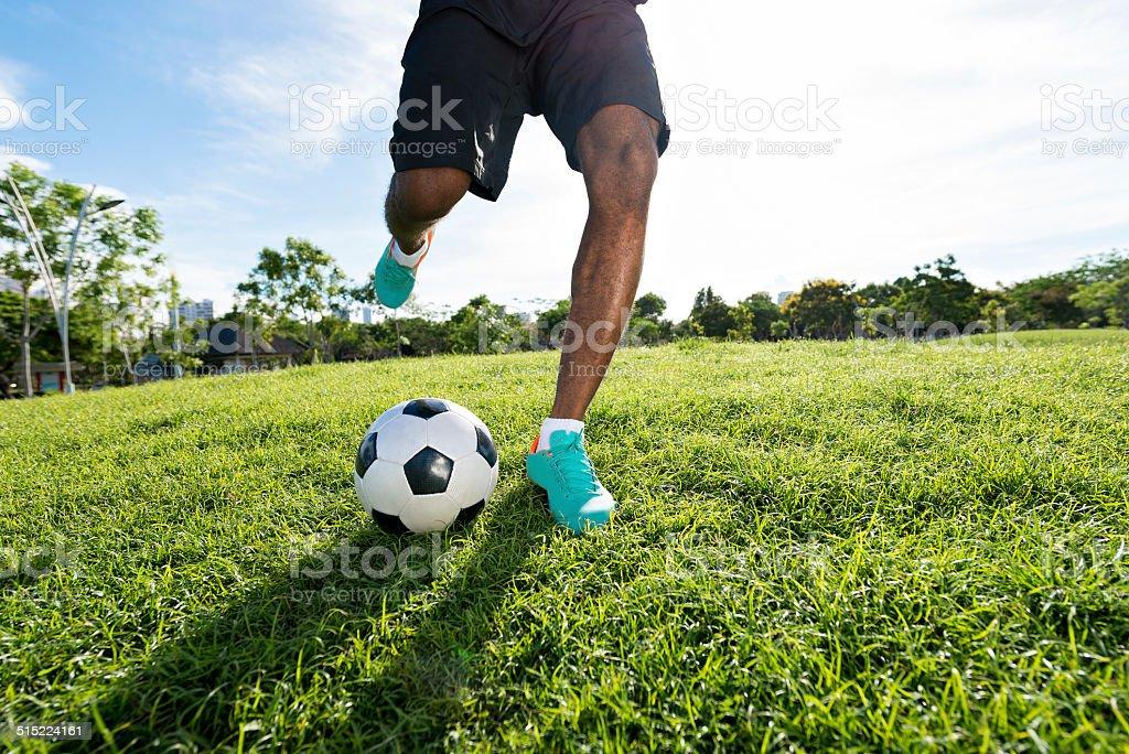 Kicking the ball stock photo