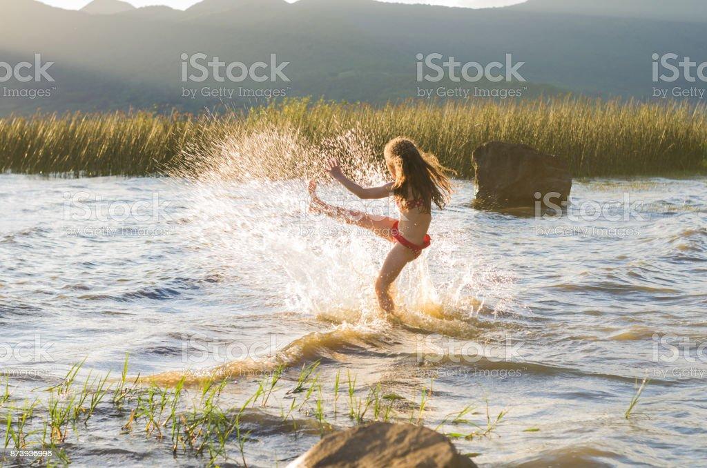Kicking the water. stock photo