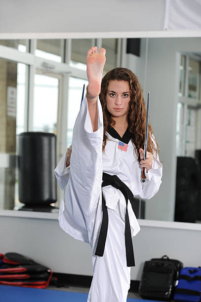 kicking with sais - martial arts gerville stock photos and pictures