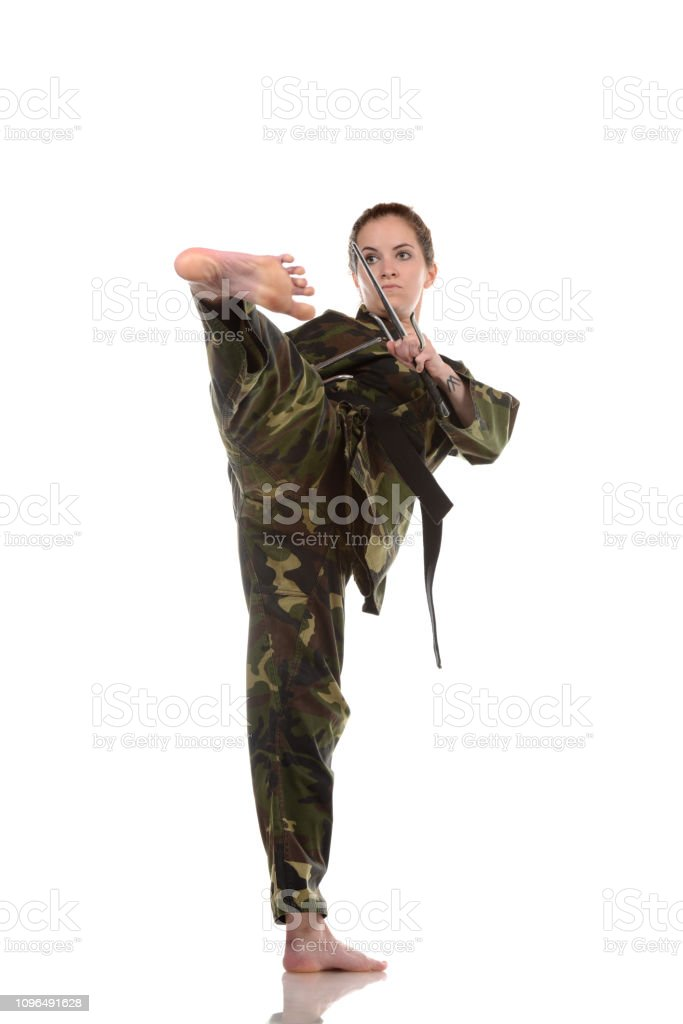 Kicking with weapons stock photo