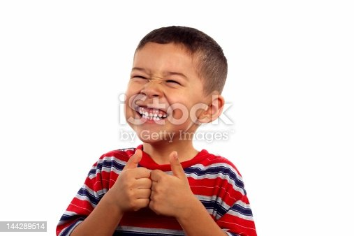 istock kid 6 years old silly face thumbs up 144289514