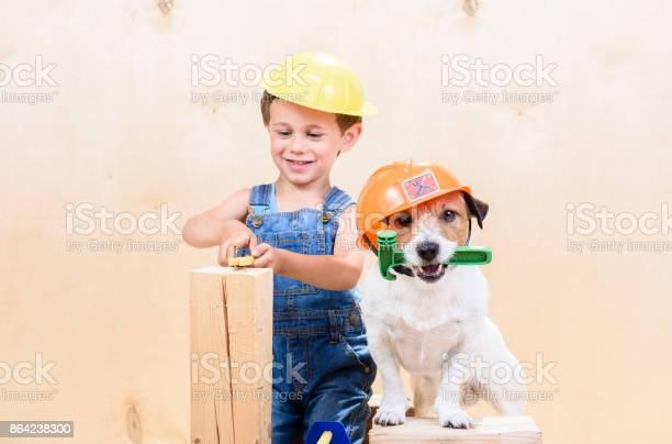 Kid and his pet at construction site working as builders picture id864238300?b=1&k=6&m=864238300&s=612x612&h=zzuwfq wrcx9m2wgiemhf x3ufc1gbqxkzpzjpap8hy=