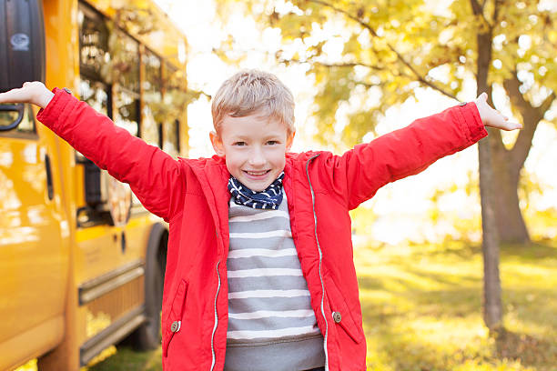 kid and school bus - getting on stock photos and pictures