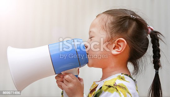 991060890 istock photo Kid announce by megaphone. 869971456