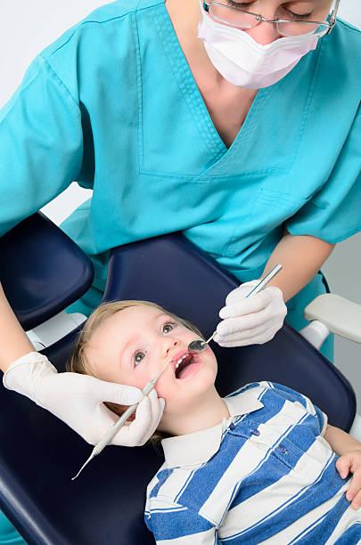 kid at dentist stock photo