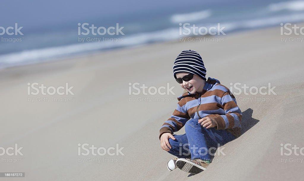 kid at dunes stock photo