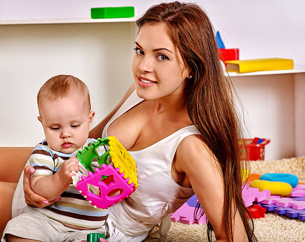 Kid baby boy with mother plying puzzle toy on floor picture id496523032?b=1&k=6&m=496523032&s=612x612&w=0&h=gjkbgbtcyhtdakutyrxtx xq1m r6fjjbgpum8s9v e=