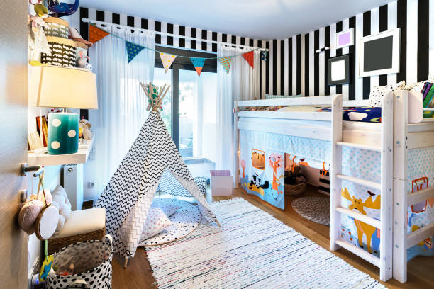 Kid bedroom with teepee and bunk bed. Kids bedroom  with bunk wooden bed, teepee, stands, carpet frames and toys. bed furniture stock pictures, royalty-free photos & images