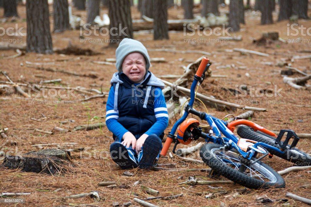 kid bike crash stock photo