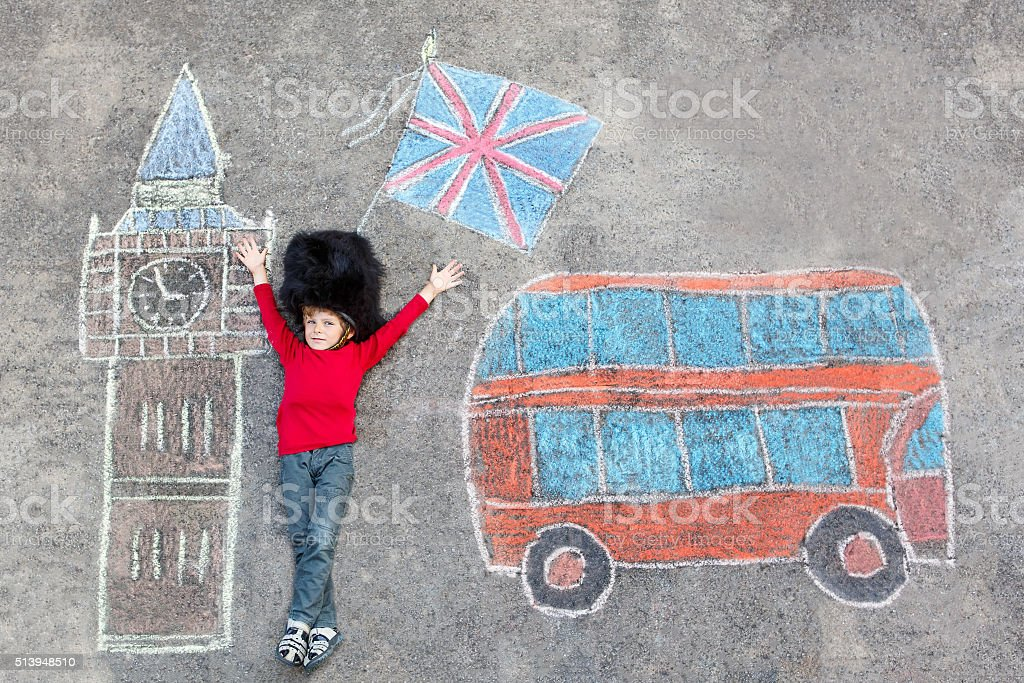 kid boy in british soldier uniform with London chalks picture stock photo