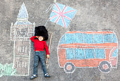kid boy in british soldier uniform with London chalks picture