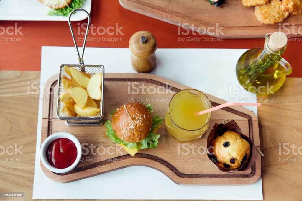 kid breakfast with mini burger, juice, cake and potato royalty-free stock photo