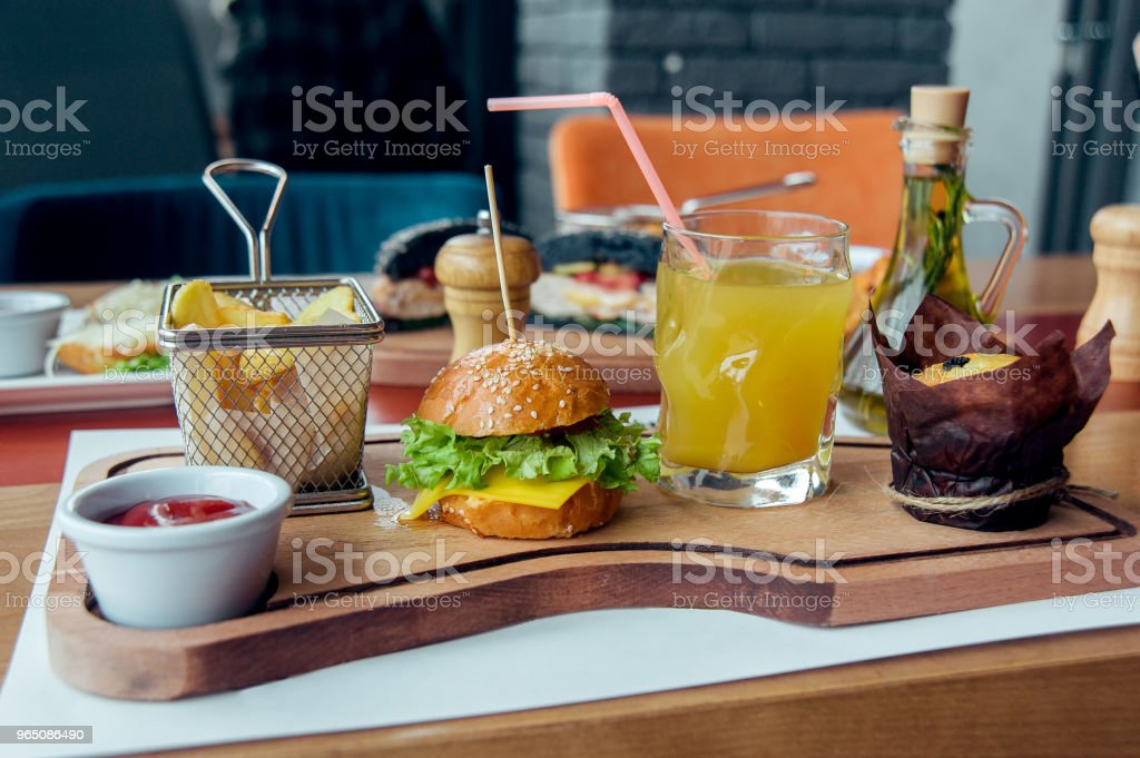 kid breakfast with mini burger, juice, cake and potato royalty-free stock photo
