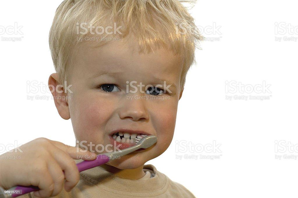 Kid brushing teeth royalty-free stock photo