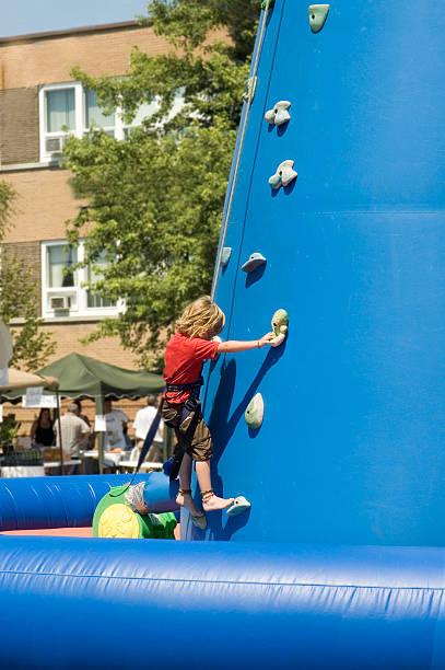 Kid climbing 3 stock photo