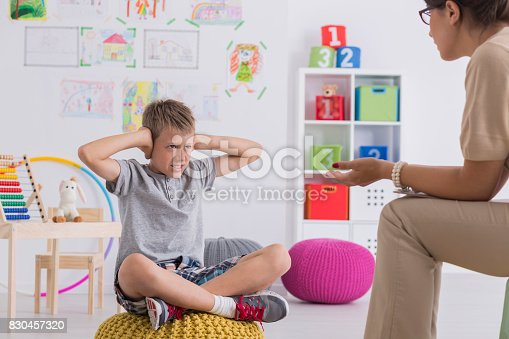 istock Kid covering his ears during therapy 830457320