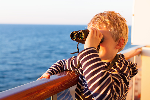kid cruising with binoculars