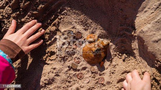 Treasure hunting: piggy bank has hidden underground