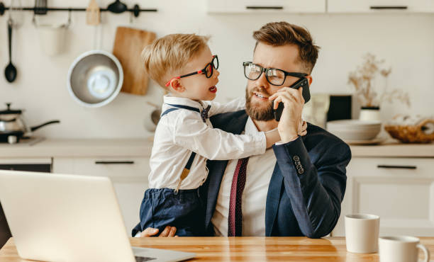 kid distracting busy father from work at home - remote work imagens e fotografias de stock