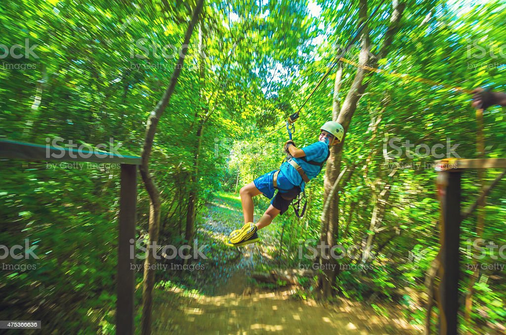 kid during a Canopy Tour in Costa Rica stock photo