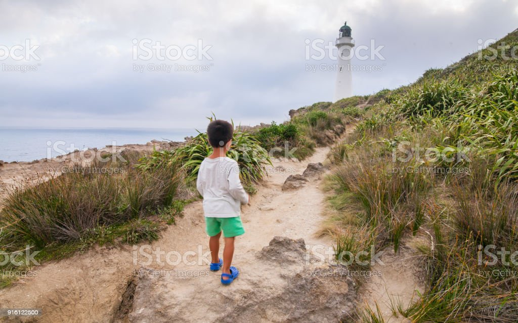 Kid during a walk at Castlepoint Lighthouse. stock photo