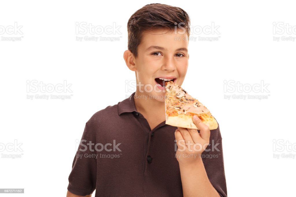 Kid eating a slice of pizza photo libre de droits