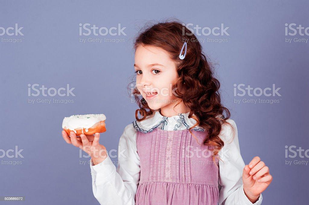 Kid eating cake stock photo