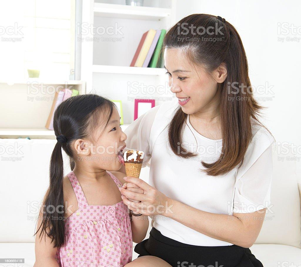 Kid eating ice-cream stock photo