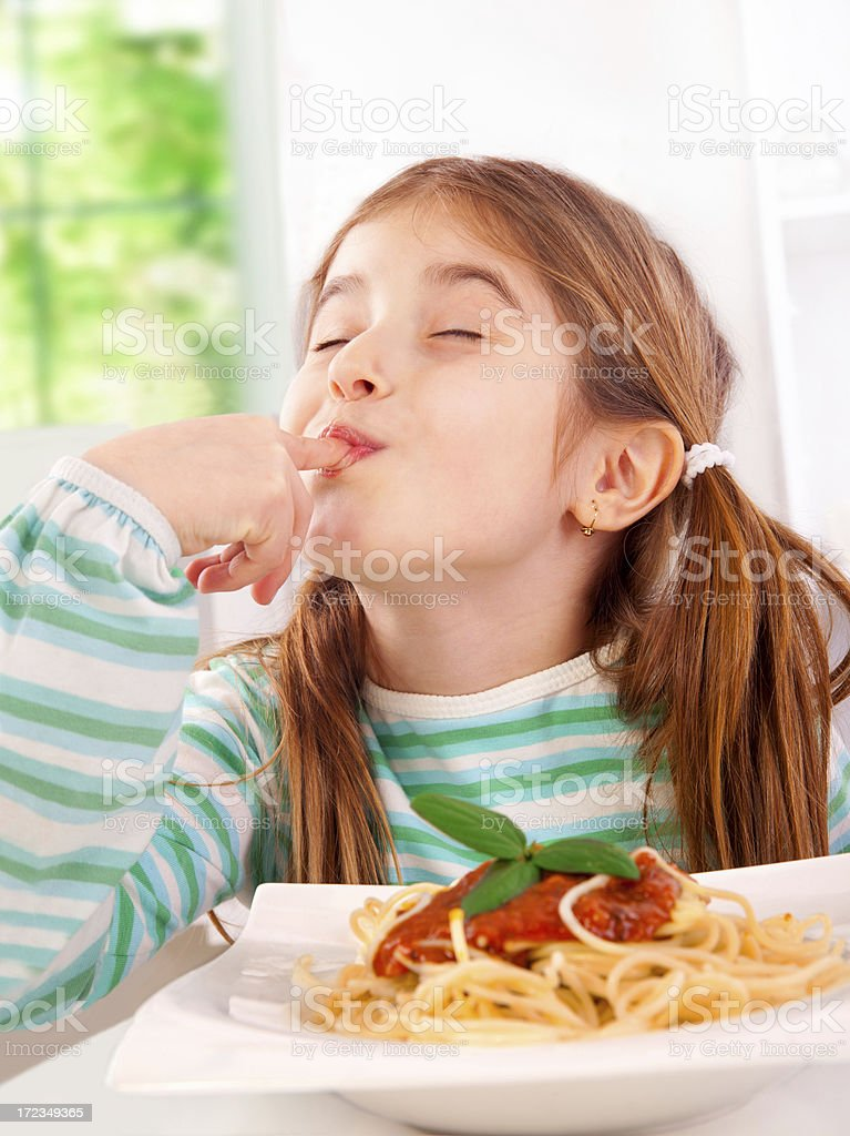 Kid eating pasta royalty-free stock photo