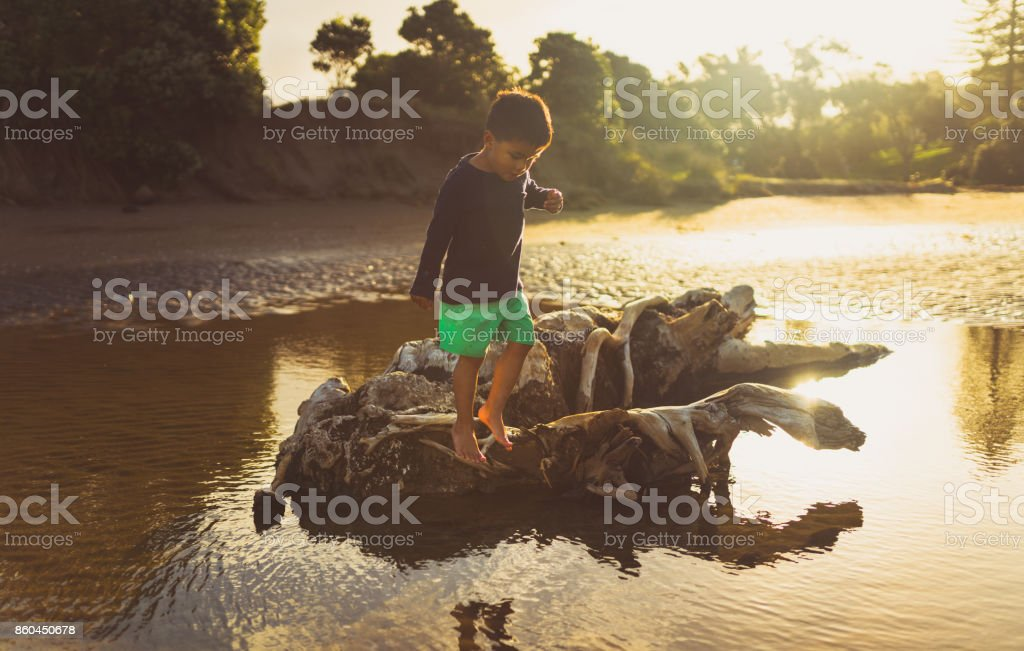 Kid enjoying outdoors playing with nature. stock photo