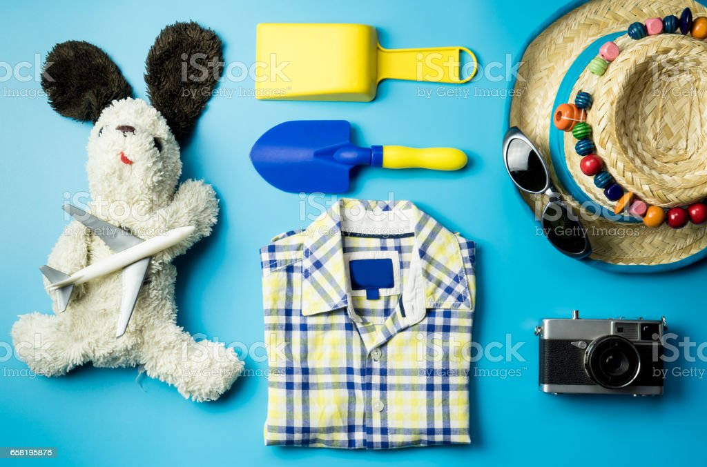 Kid fashion and beach accesories flatlay for Summer vacation theme stock photo