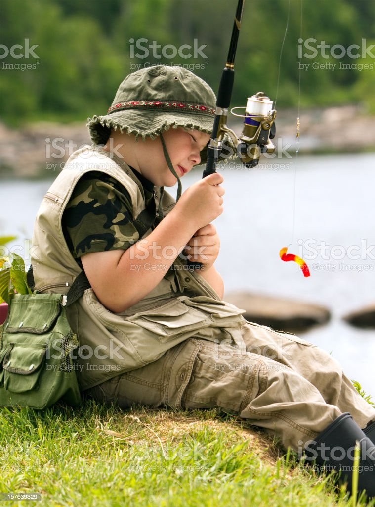 kid fishing for candy stock photo