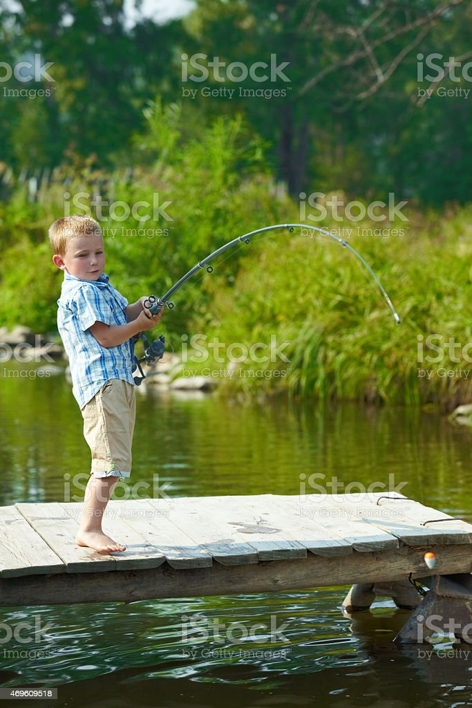 Kid fishing stock photo