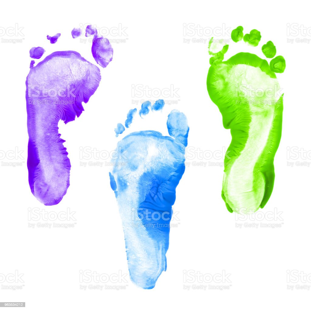 Kid foot prints colorful set isolated on white background. Many fingerprint or stamp texture artwork of kids for education and journey. Bottom view. Close up. stock photo