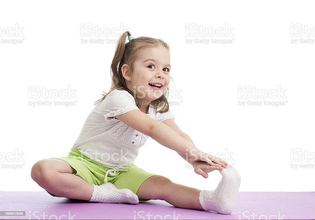 Kid girl doing fitness exercises royalty-free stock photo