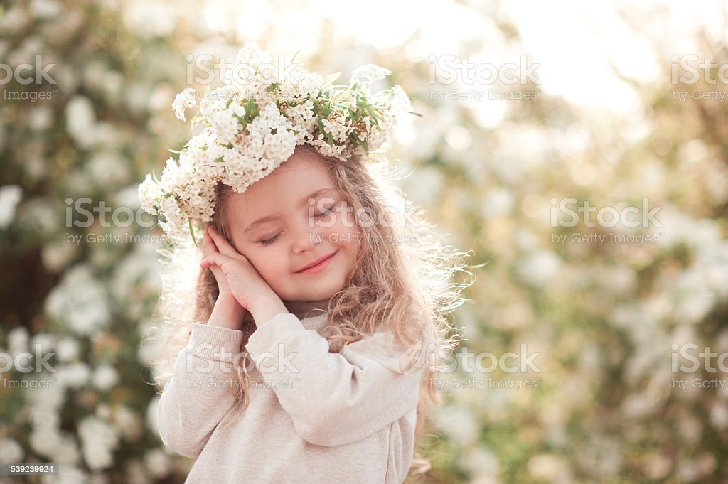 Kid girl dreaming outdoors stock photo