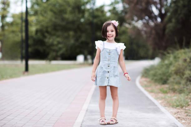 Kid girl outdoors stock photo