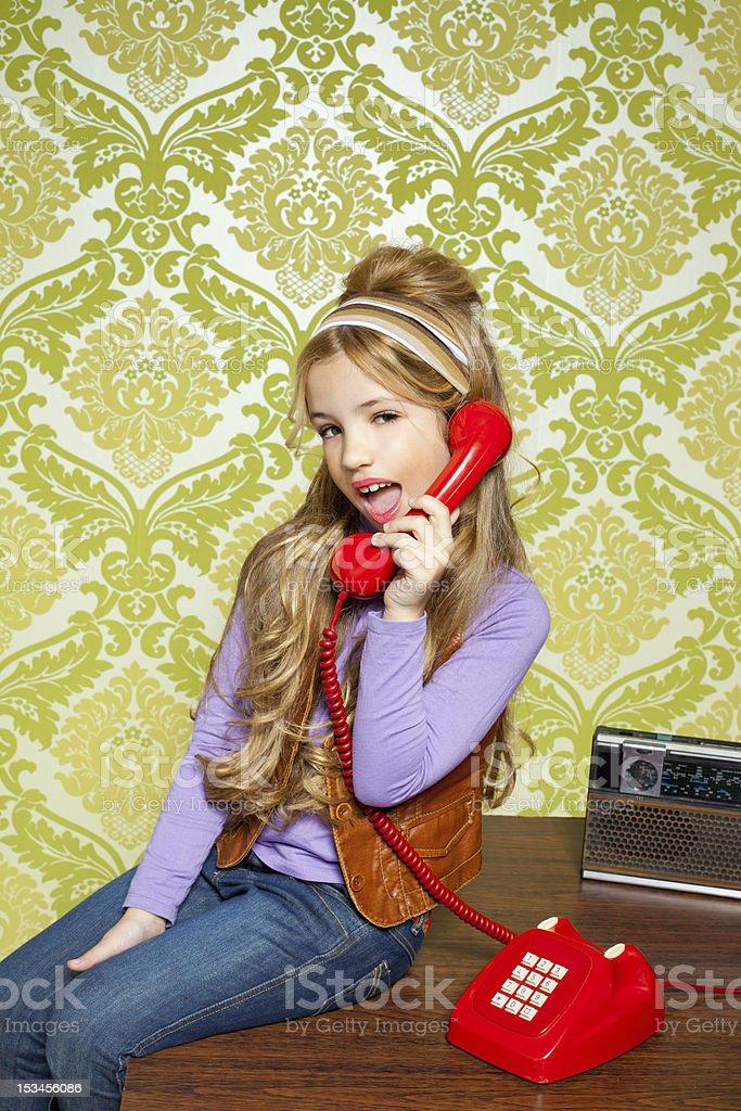 kid girl retro talking busybody in red telephone stock photo