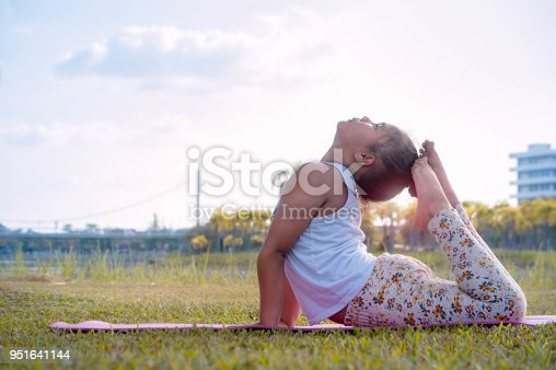511849865 istock photo kid girl's meditation practice yoga concentration in the nature park on the  day 951641144