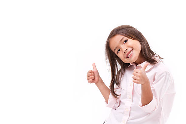 kid giving two thumbs up stock photo