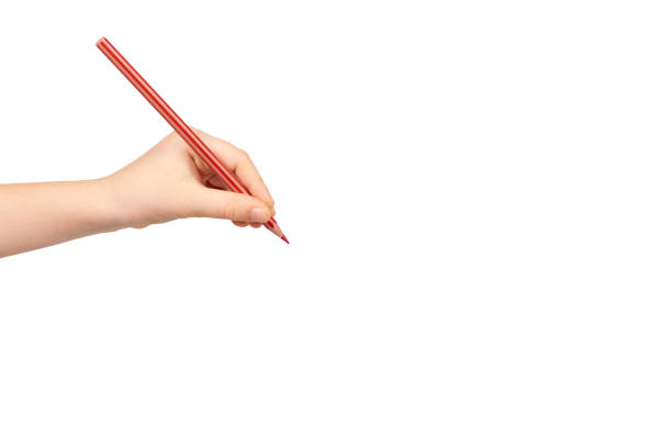 Kid handholding kleurpotlood, schrijven en tekenen gebaar. foto