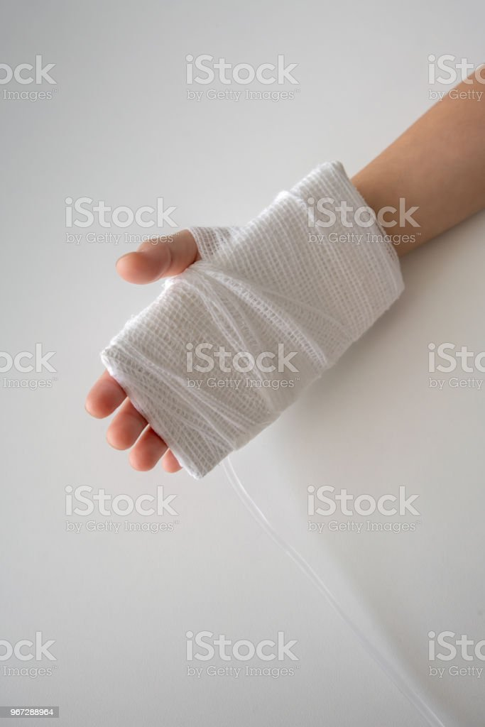 Kid Hand With An Elastic Bandage With The Tube Of Normal Saline