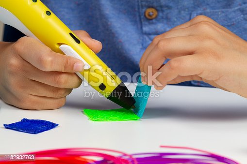 899701486 istock photo Kid hands creating with 3d printing pen new item 1182932763