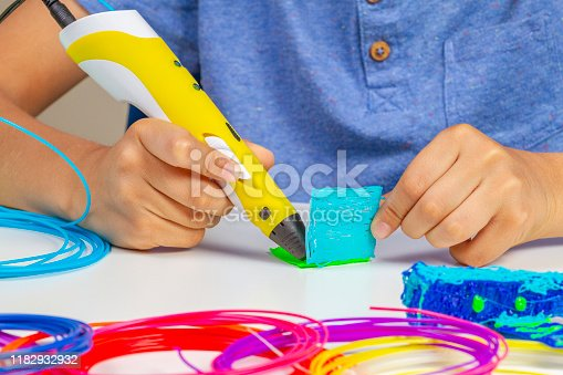 899701486 istock photo Kid hands creating with 3d printing pen new item 1182932932