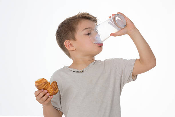 kid has breakfast stock photo
